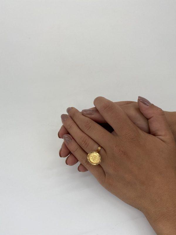 "Mesure et art du temps - Ring Coins 2 Yellow Gold Pesos 24 Carats Estados Unidos Mexicana Solid 24 karats gold ring, eagle head hallmark, set with a gold coin of Dos Pesos Mexicanos, with the effigy of an eagle ""Estados Unidos Mexicanos"", dated 1945, 20th century. Size : 54 FR; 6,75 US; N UK"
