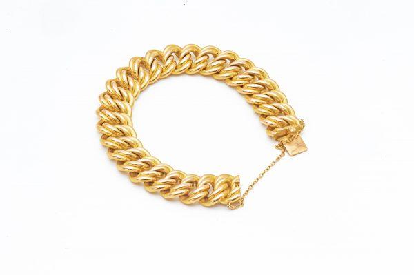 Mesure et art du temps - Bracelet, Armlet, en Or Jaune 18 Carats avec Chainette Armlet avec un fermoir et une chainette pour sécuriser le bracelet à votre poignet. Largeur : 1,6 cm Longueur : 20 cm